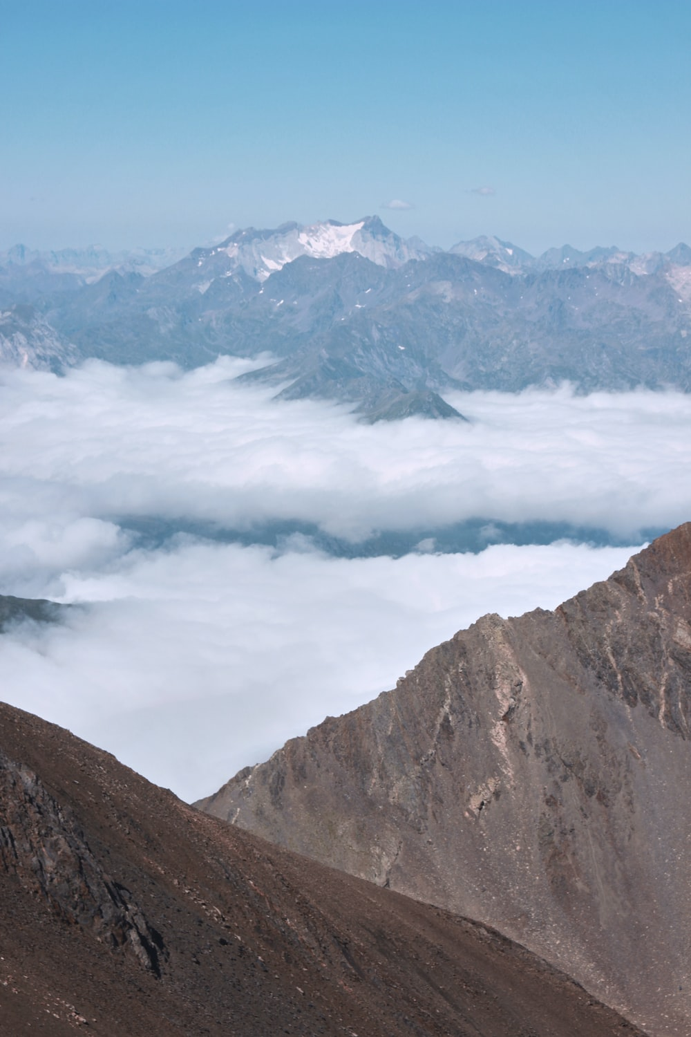 brown and gray mountains under white clouds during daytime