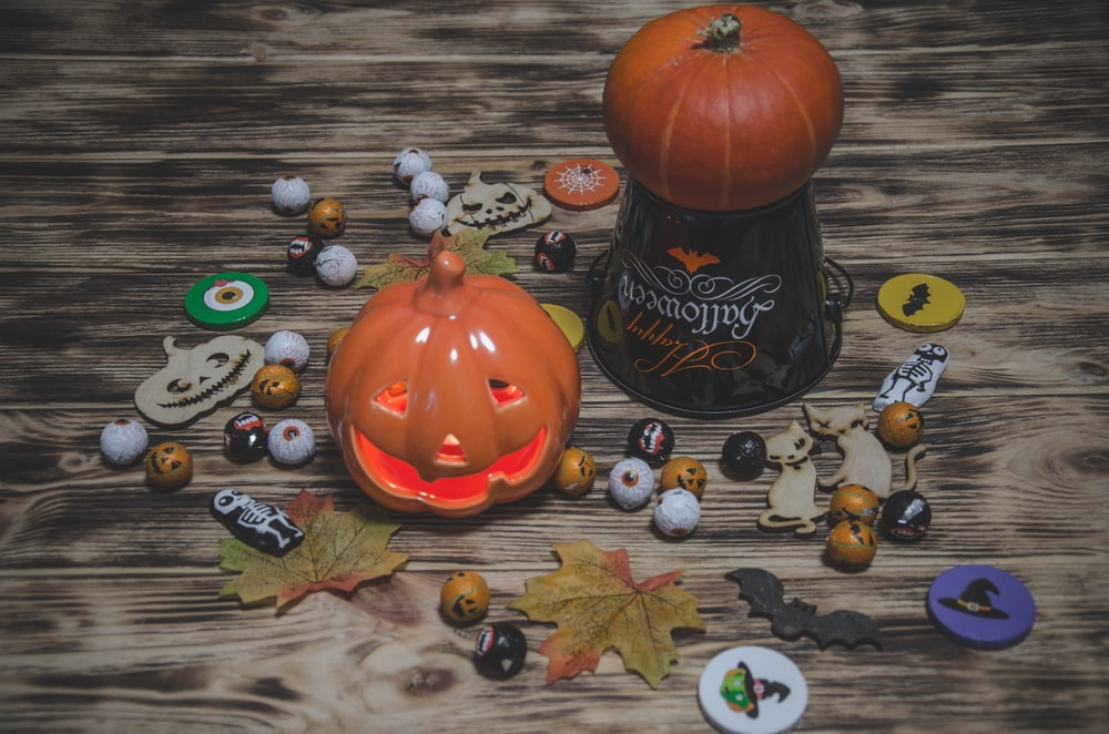 pumpkin on black and brown wooden table
