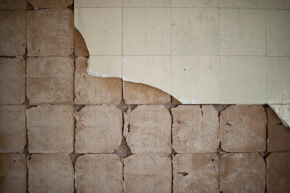 brown concrete blocks on white ceramic tiles