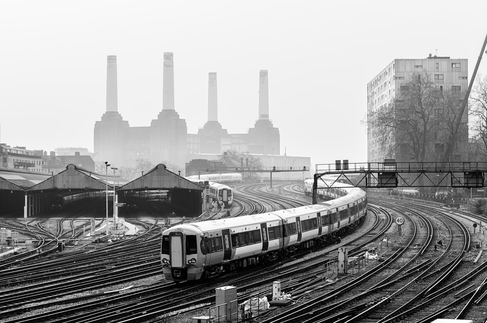 grayscale photo of train on rail tracks