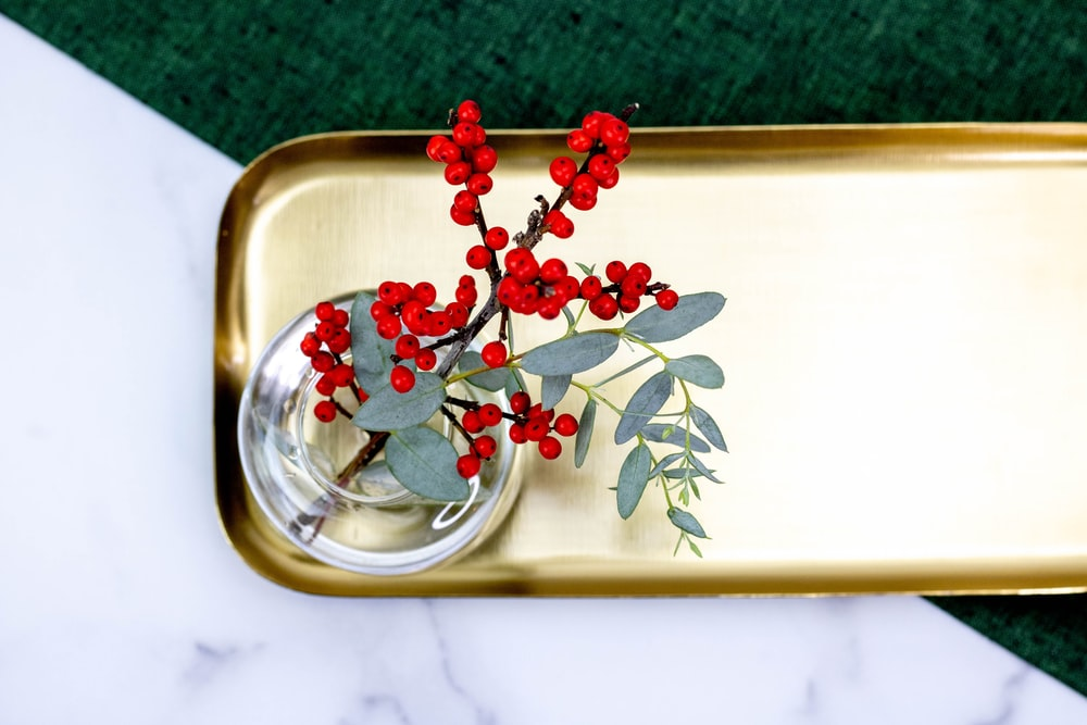 red and green flower on clear glass bowl