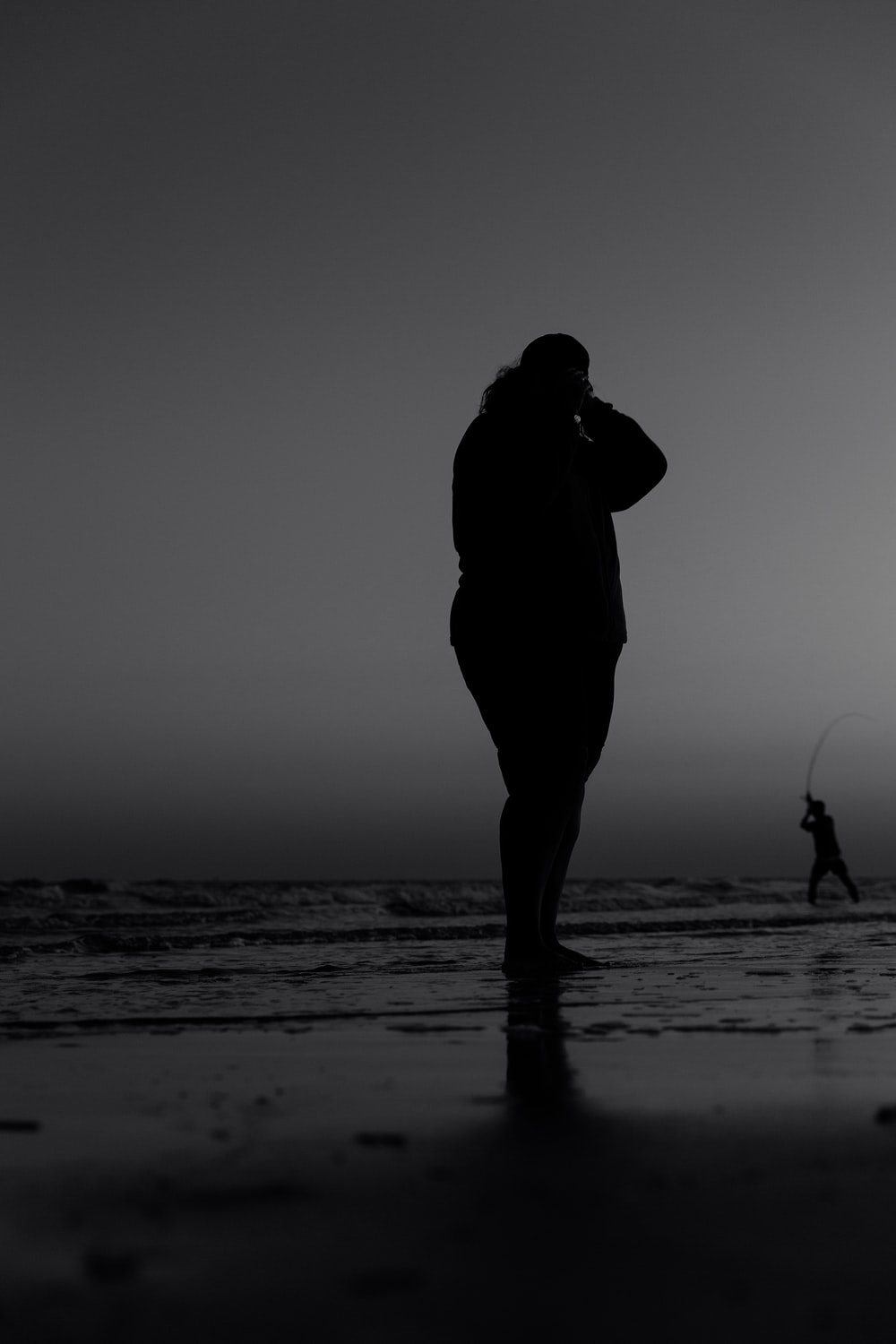 silhouette of man and woman kissing on beach during sunset