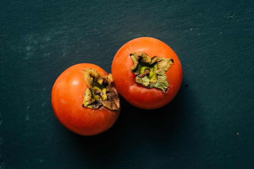3 red tomato on black textile