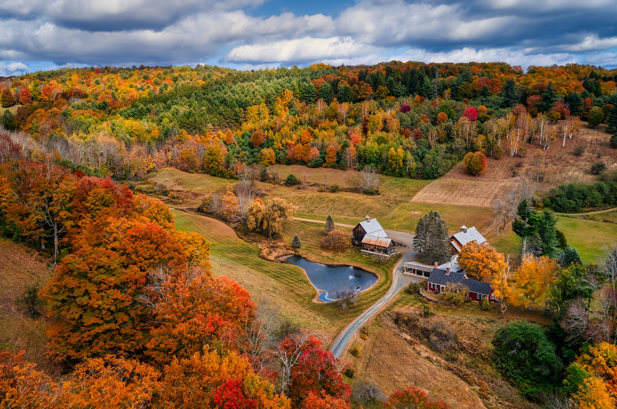 Scenic Vermont: A barn nestled in a valley during fall.