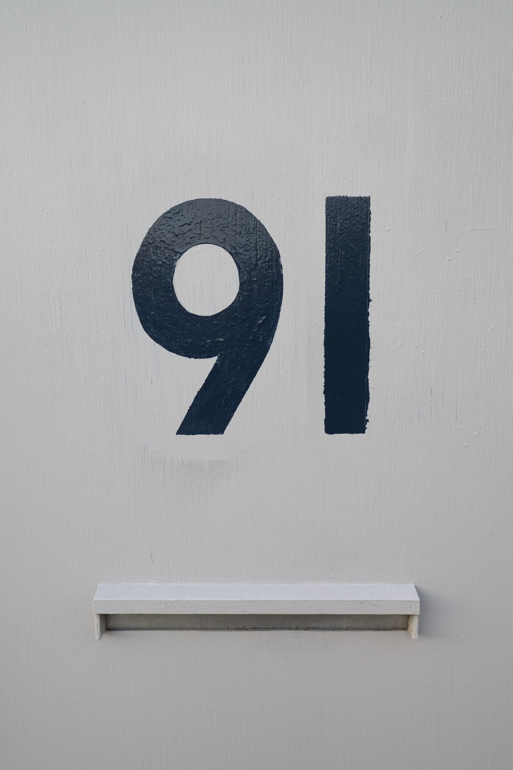 blue and white number 9 wall decor