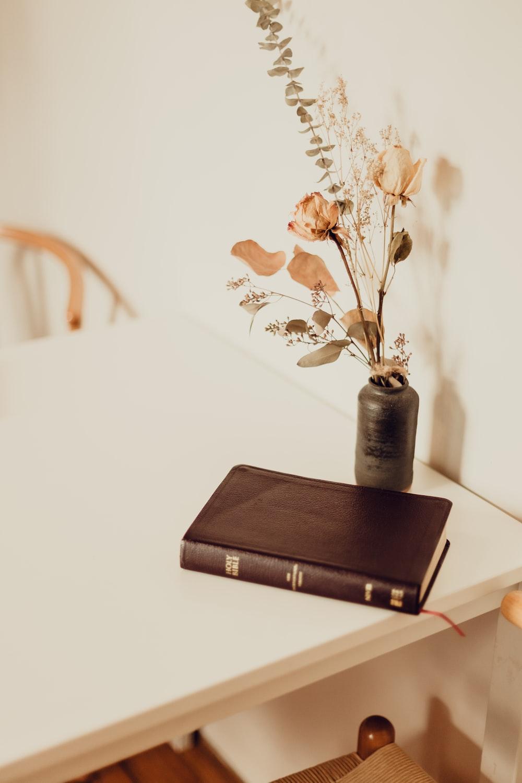 black hardbound book on white table