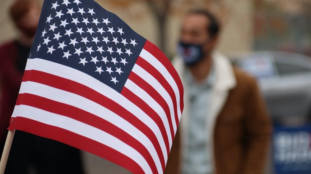 us a flag on mans shoulder