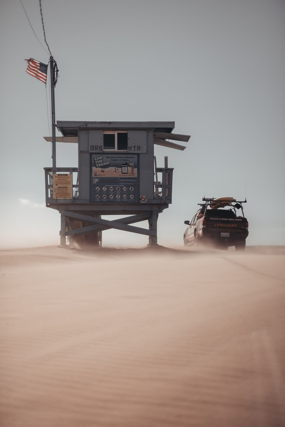 black and brown car on gray metal tower