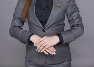 woman in black suit jacket