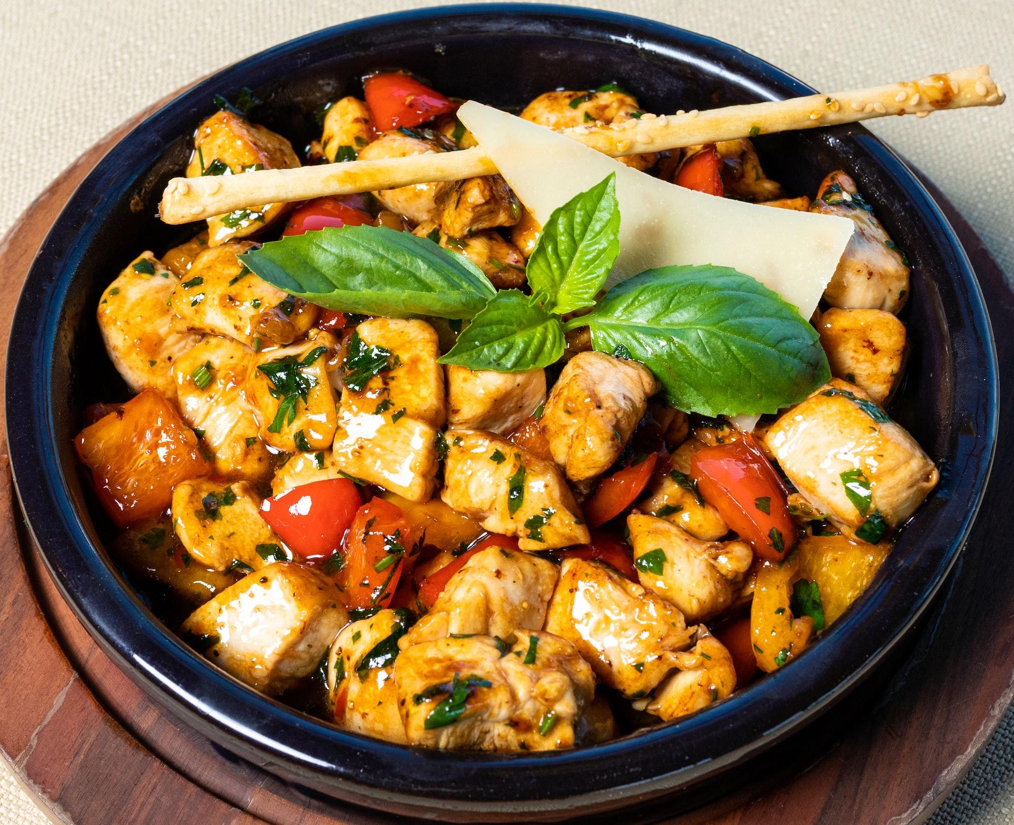 Chicken, tomato salad close up