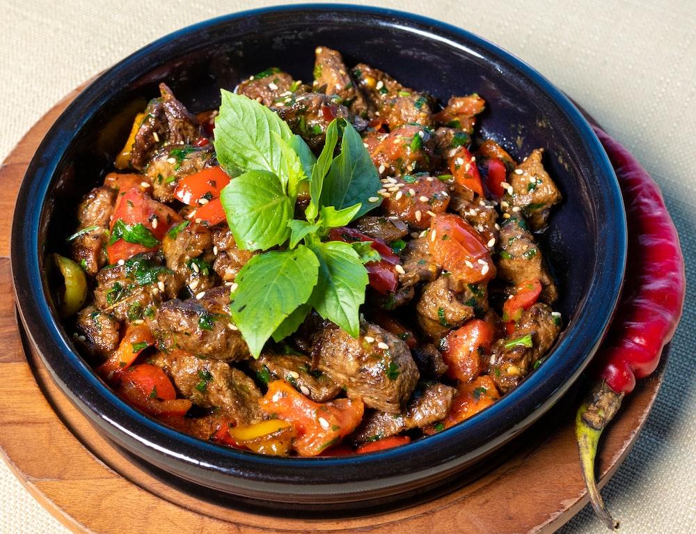 vegetable dish on blue ceramic bowl