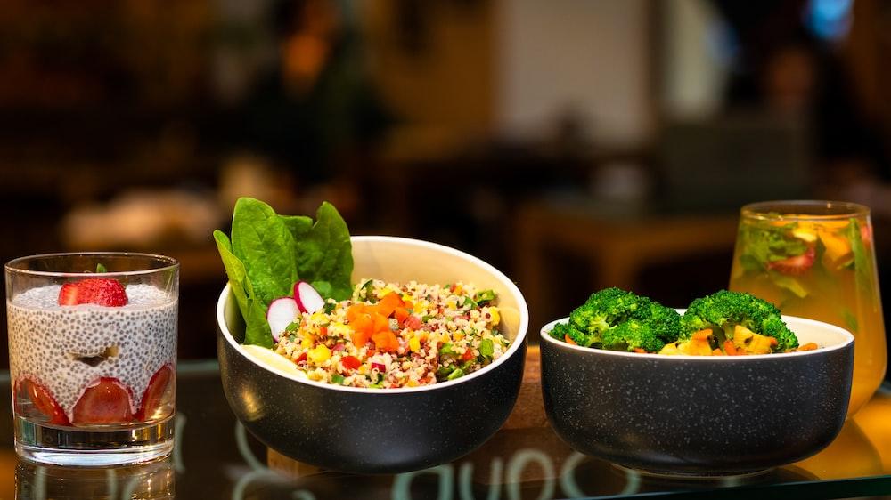 green vegetable in black ceramic bowl