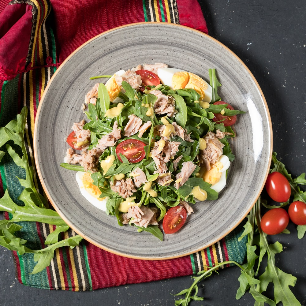 vegetable salad on white ceramic bowl