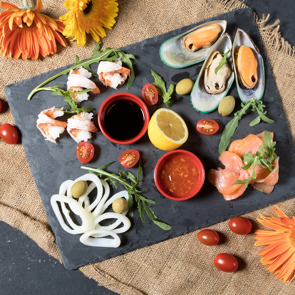 sliced vegetables on black ceramic plate