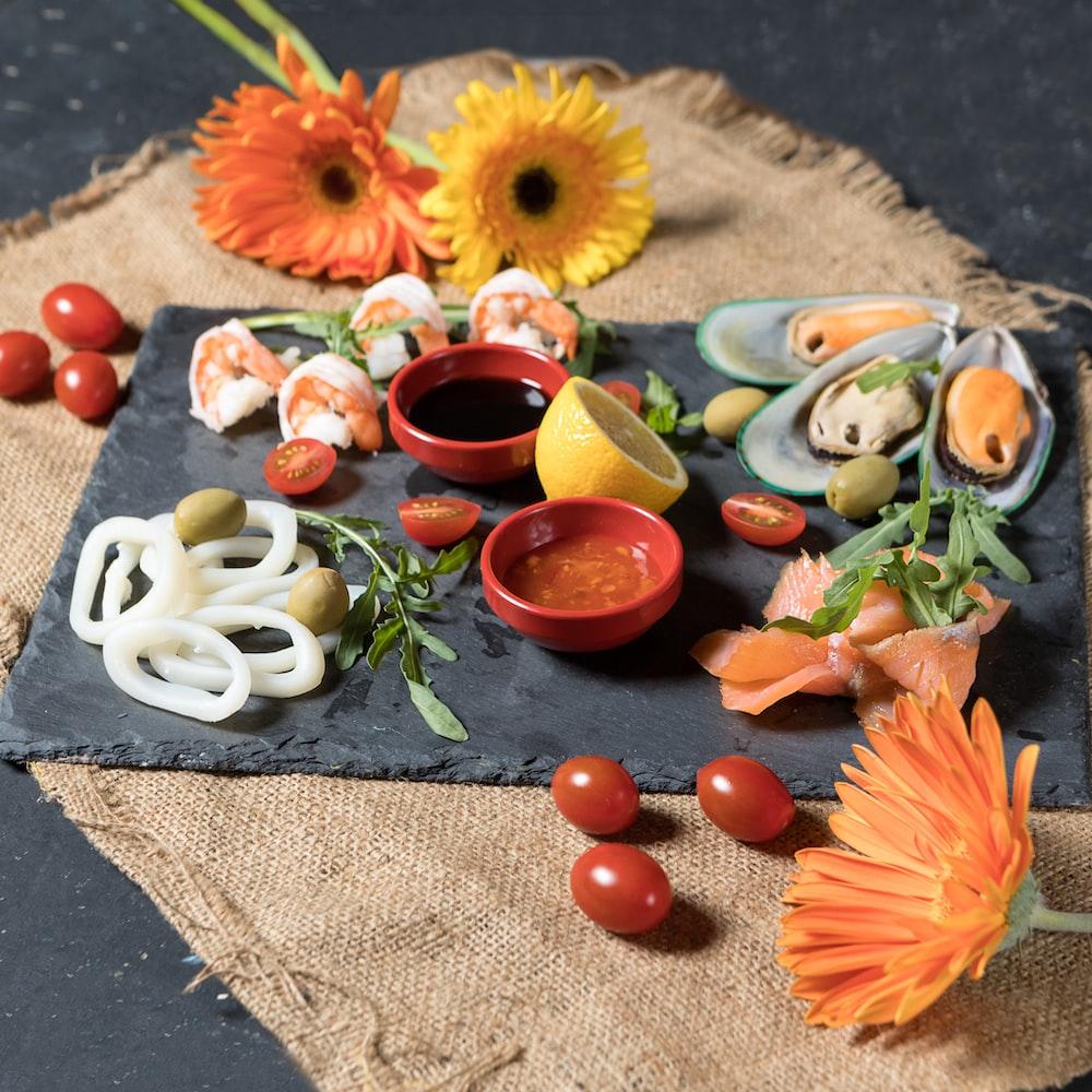 sliced fruits on white ceramic bowl