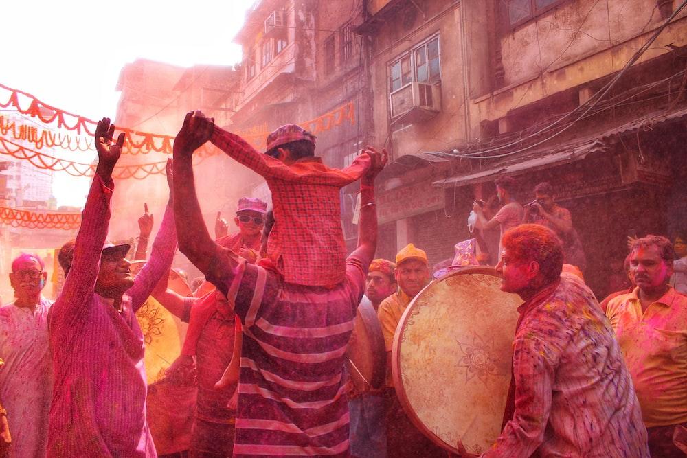people dancing on street during daytime