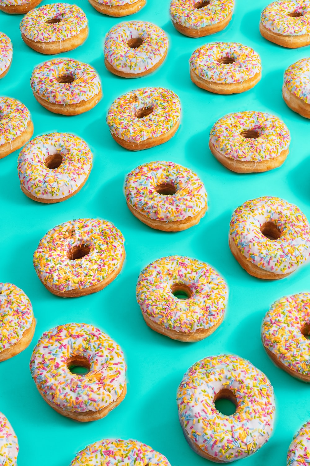 white and pink donuts on white surface
