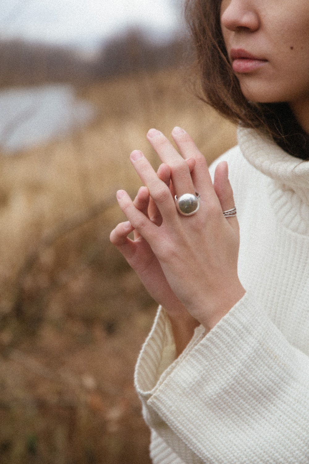 woman wearing silver ring with purple gemstone