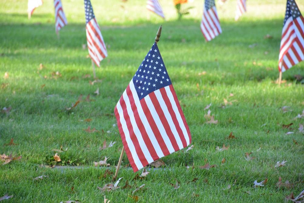 us a flag on green grass field