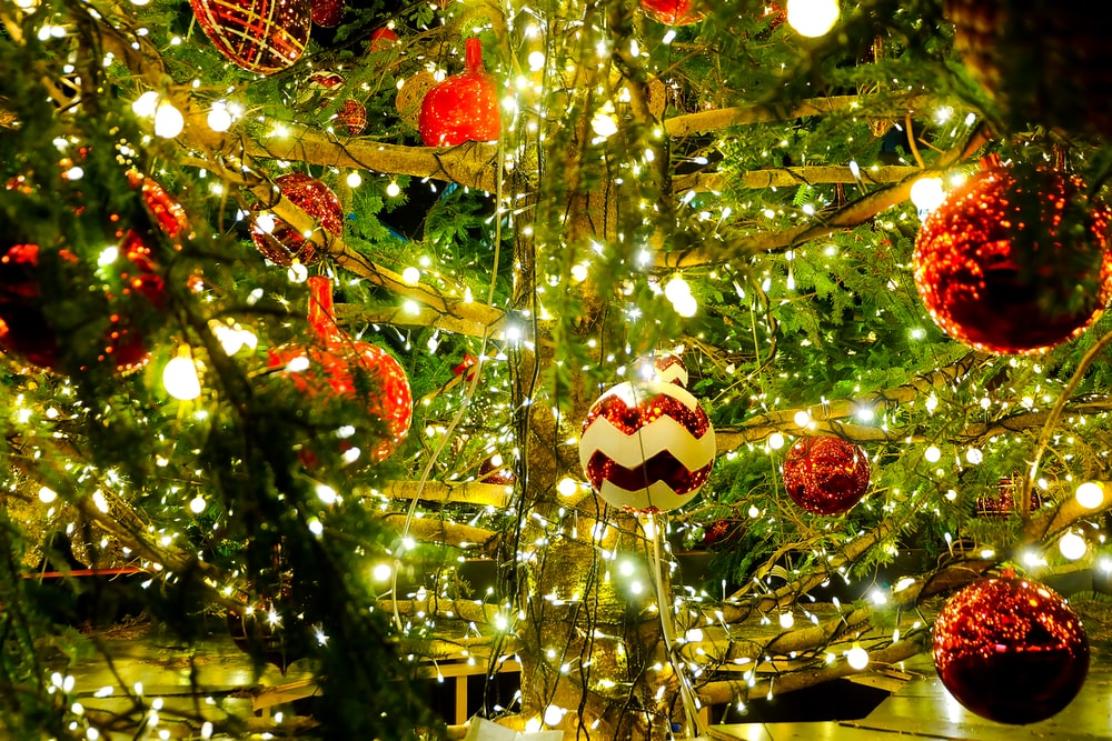 red and white baubles on green christmas tree