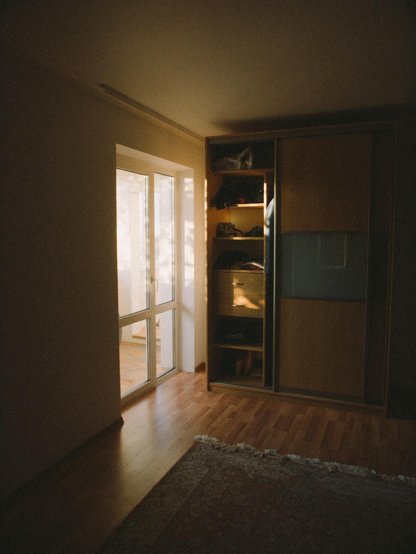 brown wooden cabinet near brown wooden door