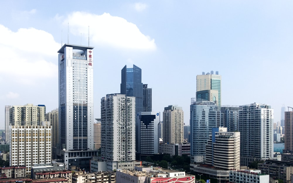 white and gray high rise buildings during daytime