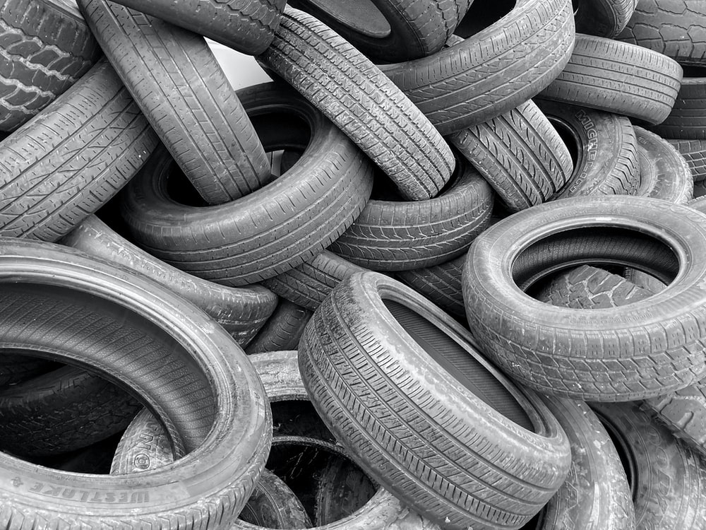 grayscale photo of a pile of round metal