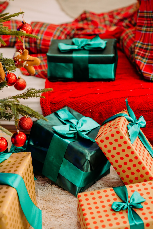 green and white polka dot gift box beside red and white polka dot gift box
