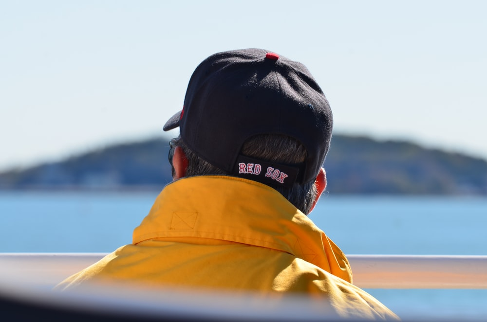man in yellow jacket and black knit cap