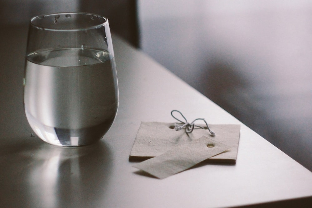 clear drinking glass on white tissue paper