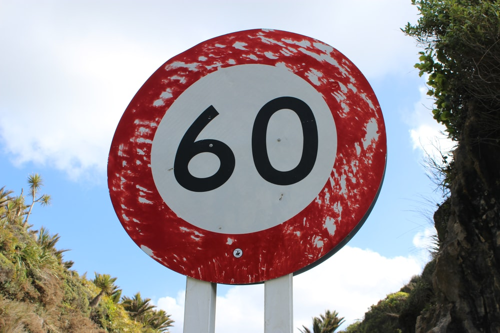 red and white round sign