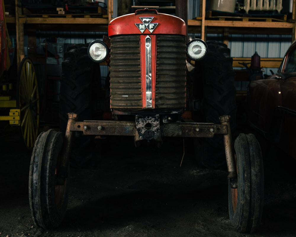 red and black tractor in garage