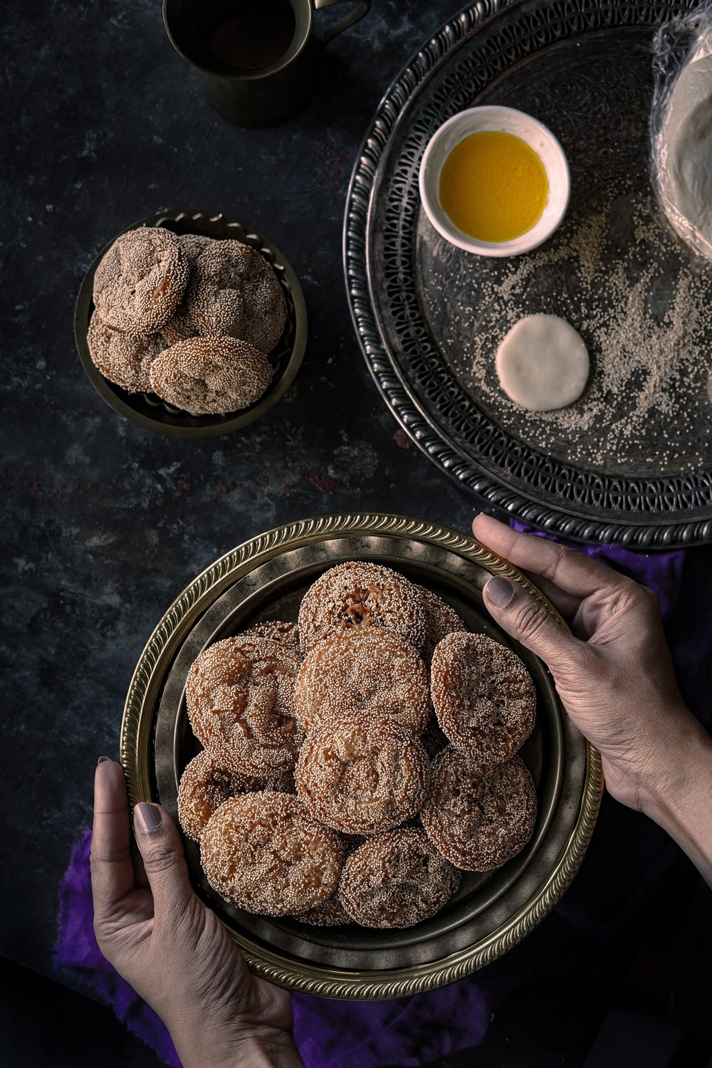person holding brown round cookies