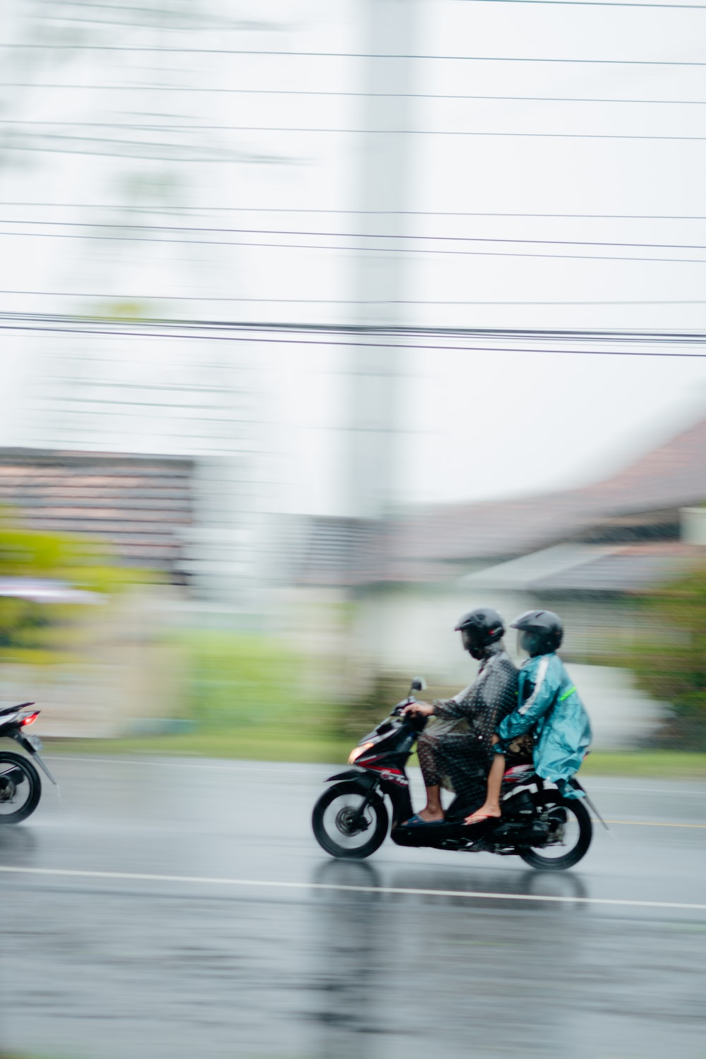 man and woman riding motorcycle on road during daytime