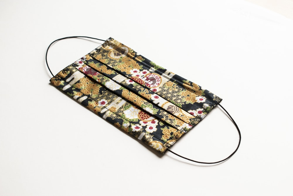 yellow and black floral sling bag