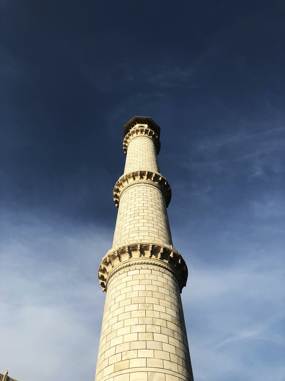 white and brown tower under blue sky