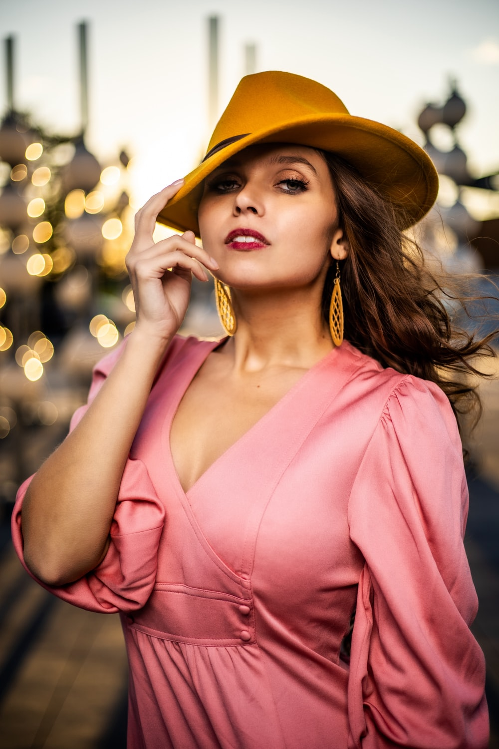 woman in pink v neck shirt wearing brown hat