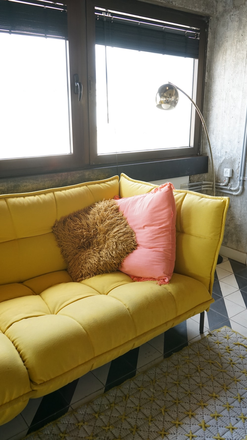 brown throw pillow on yellow couch