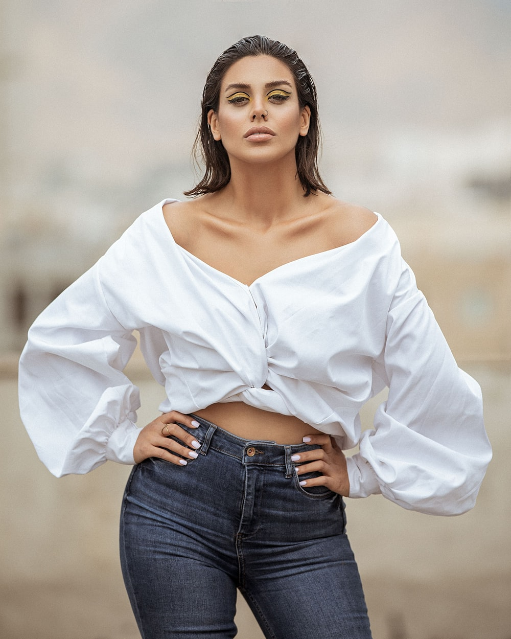 woman in white long sleeve shirt and blue denim jeans