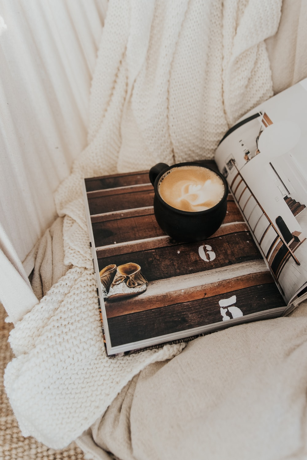 white ceramic cup on brown wooden tray