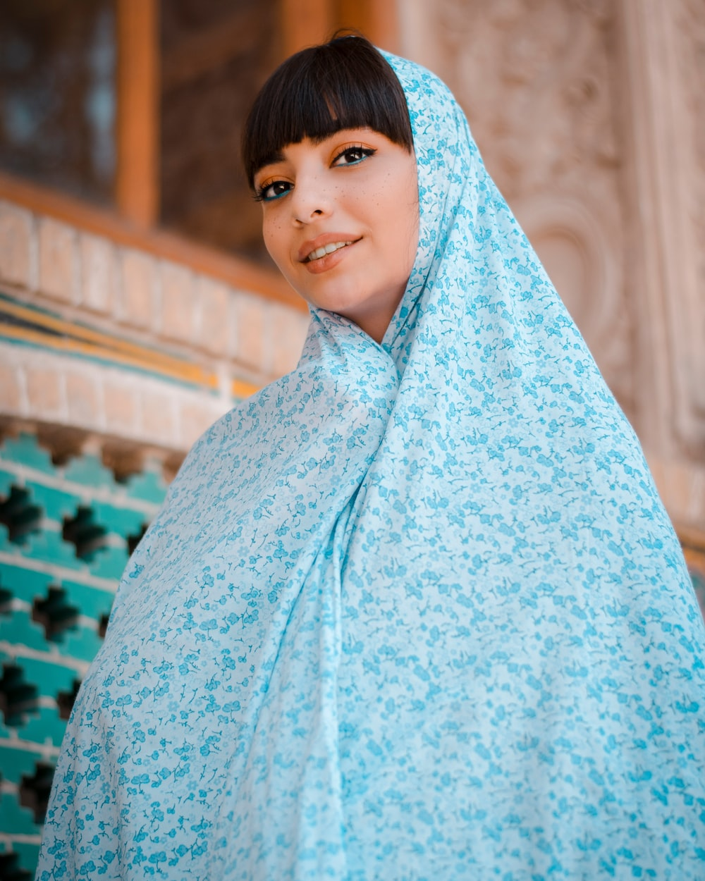 woman in blue hijab standing