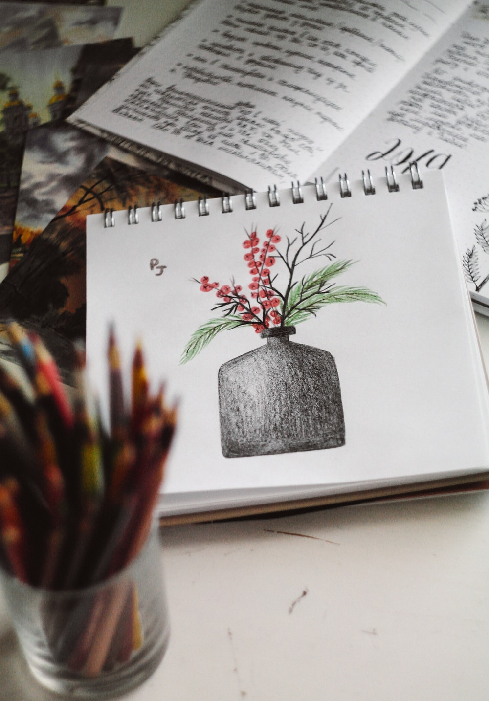 green and red plant on white book page