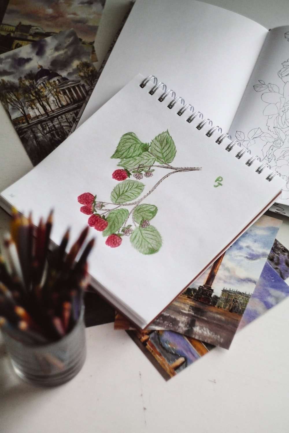 green and red plant on white paper