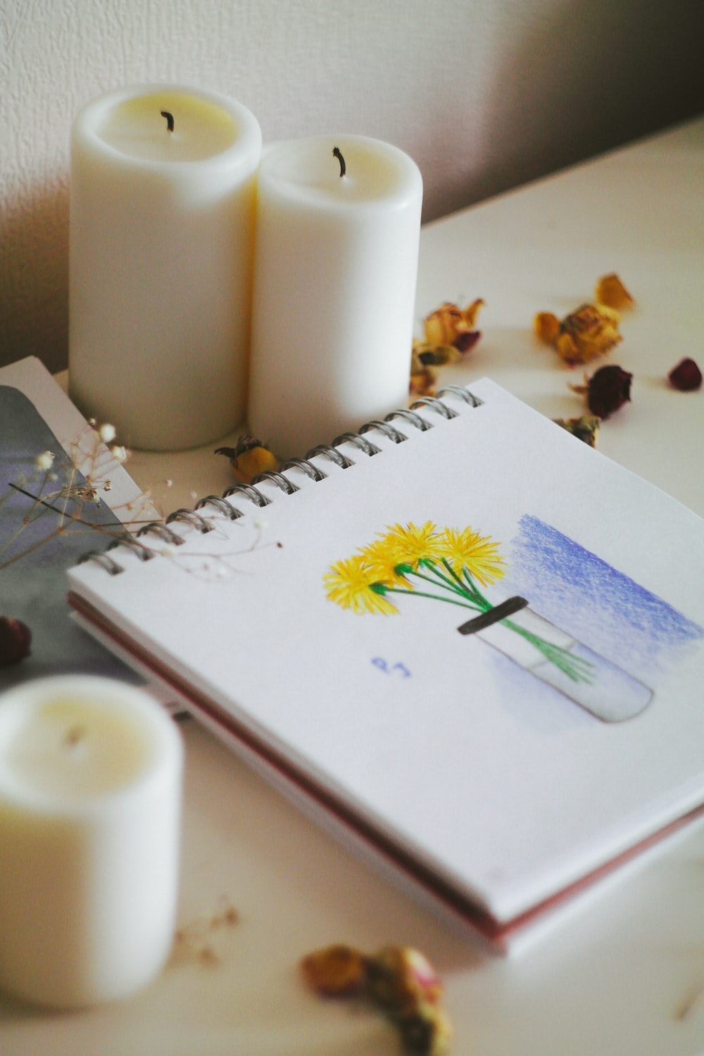 white paper with yellow and green flower drawing