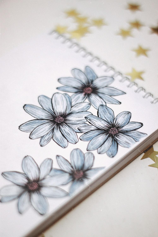 blue and white flower illustration
