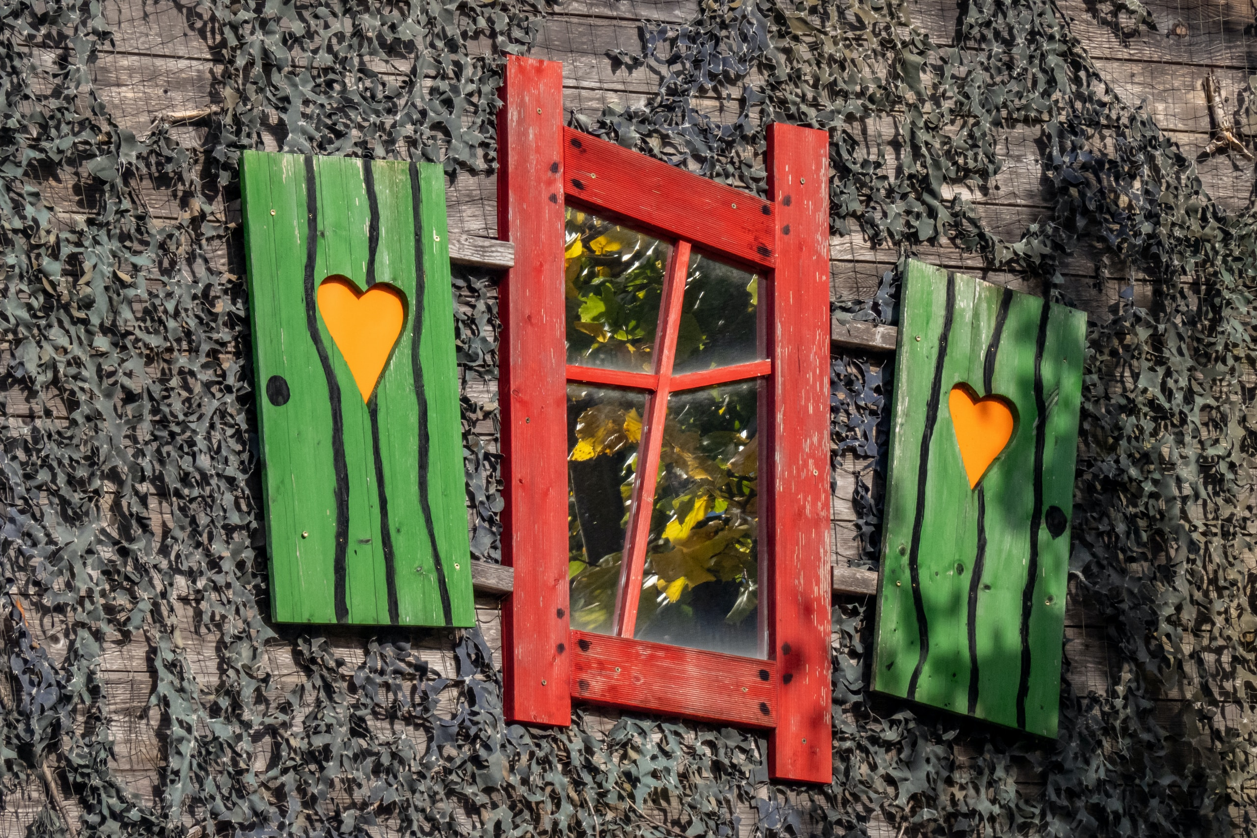 brown wooden frame with green and yellow heart print