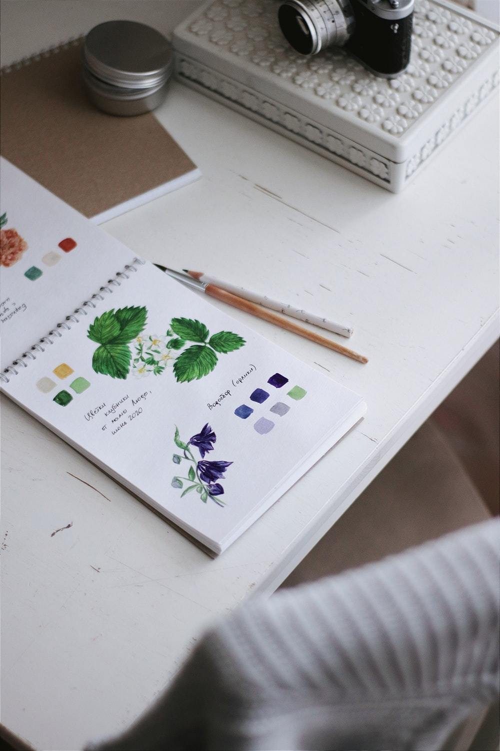 white and green floral book