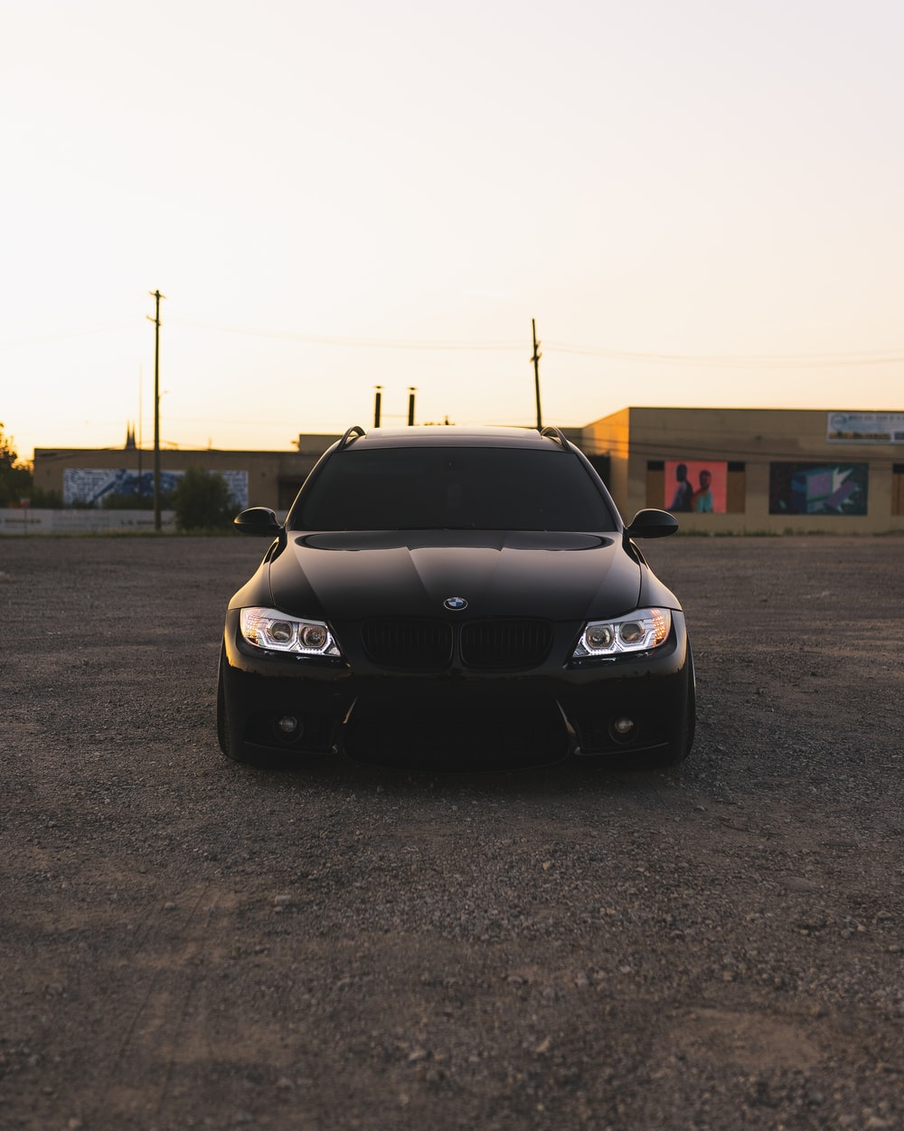 black bmw m 3 parked on parking lot during daytime
