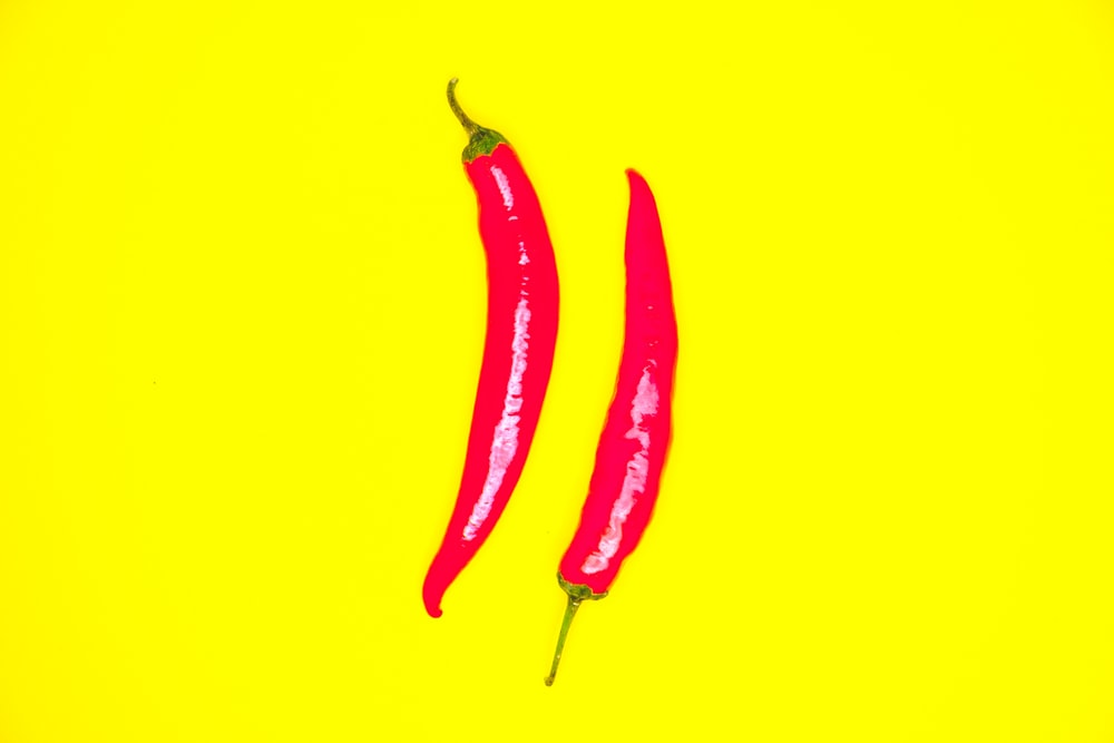 red chili on yellow background