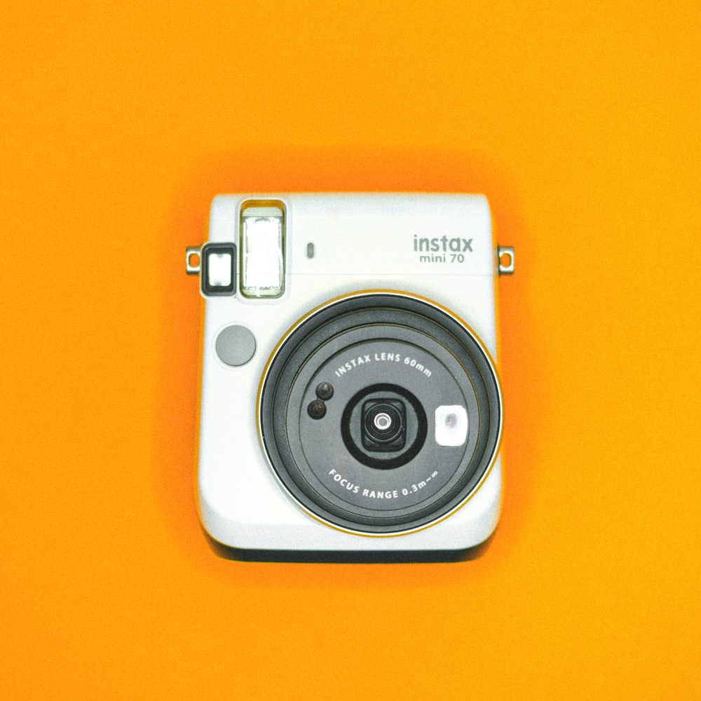 white and silver point and shoot camera